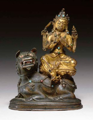 A GILT BRONZE FIGURE OF MANJUS