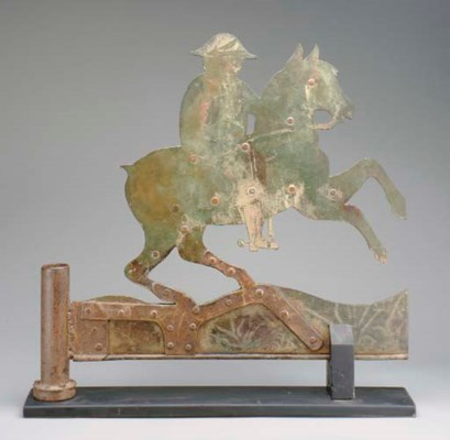 A SHEET-METAL HORSE AND RIDER