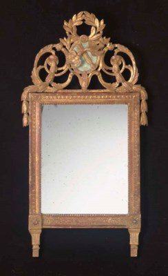 A LOUIS XVI CARVED GILTWOOD AN