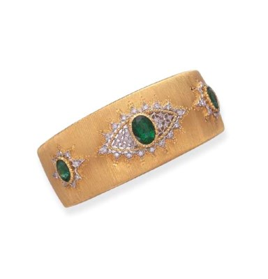 AN EMERALD DIAMOND AND GOLD BR