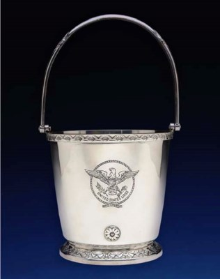An ice pail with a decorated b