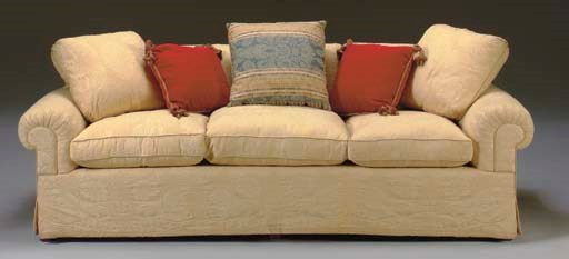 AN UPHOLSTERED THREE-CUSHION S
