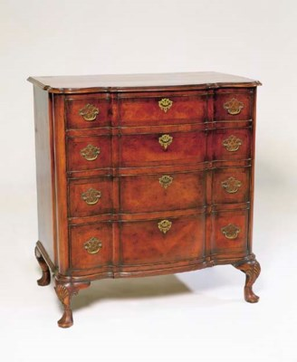 A WALNUT CHEST OF DRAWERS