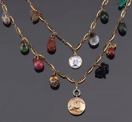 A NECKLACE WITH EGG CHARMS