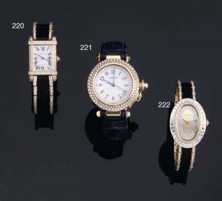 A LADY'S 18K GOLD AND DIAMOND-