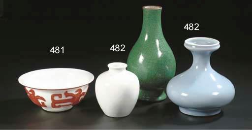 A pale blue glazed vase