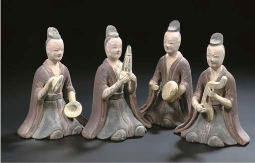 A set of four grey pottery pai