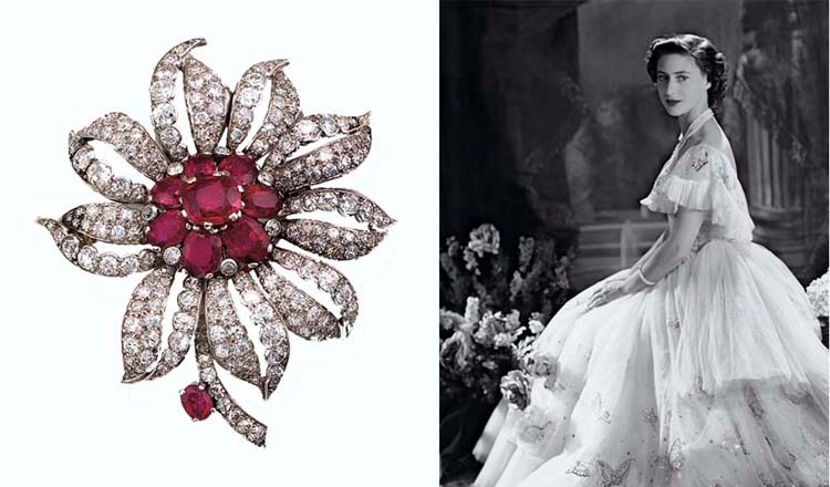 A ruby and diamond flower brooch, by Cartier from the Collection of H.R.H. The Princess Margaret, Countess of Snowdon. Sold for £108,000 on 13 June 2006  at Christie's London. According to Cartier Geneva, this brooch, made by Cartier London in 1948, was originally a clip brooch that had been converted into a pin-fitting brooch — hence the absence of a signature
