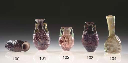 A ROMAN AUBERGINE GLASS AMPHOR