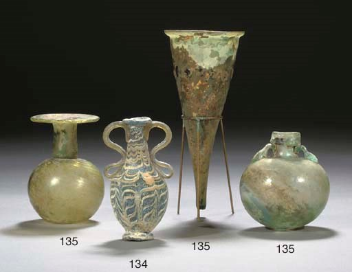 A ROMAN GREEN GLASS CONICAL BE