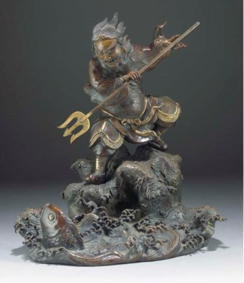 A Japanese bronze model of a w