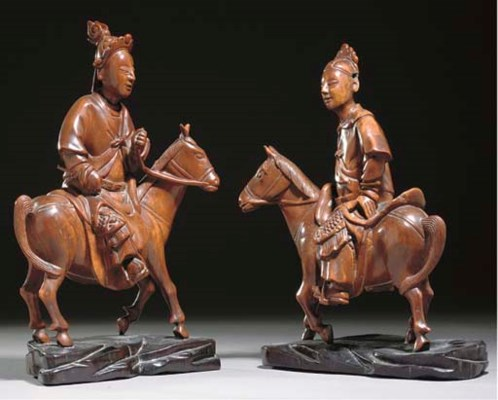 A Pair of Chinese wooden eques