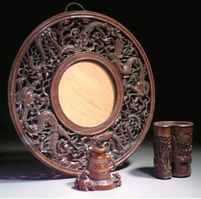 A Chinese wooden circular mirr