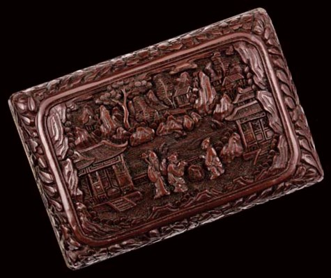 A Chinese carved brown lacquer