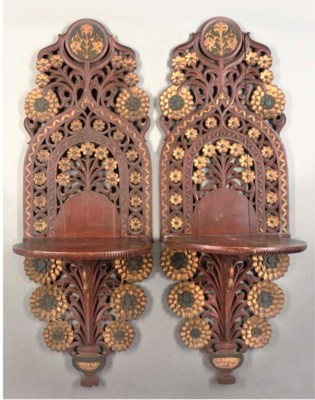 A PAIR OF GILDED WOODEN TURBAN