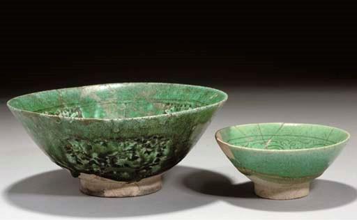 Two Nishapur green-glazed pott