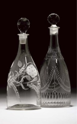 TWO DECANTERS AND TWO STOPPERS
