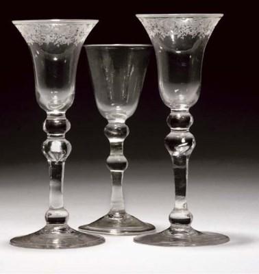 THREE BALUSTROID WINE-GLASSES