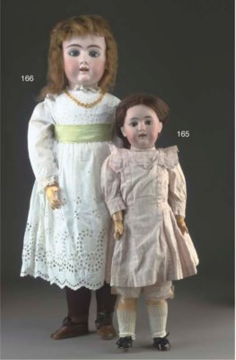 A German child doll marked R.H