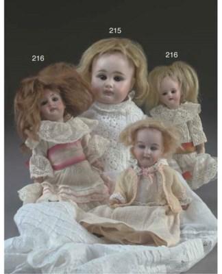 Three small dolls