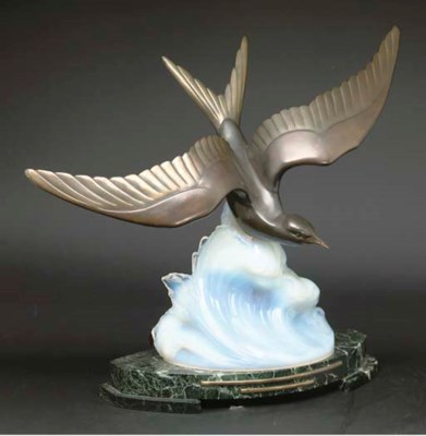 A FRENCH PATINATED SPELTER AND