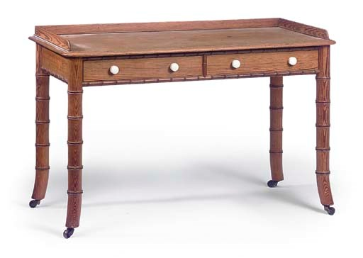 A VICTORIAN PINE WRITING TABLE