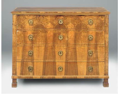 AN AUSTRIAN FIGURED WALNUT COM