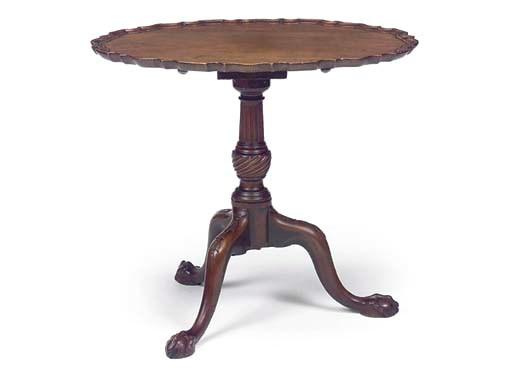 A MAHOGANY OVAL TRIPOD TABLE