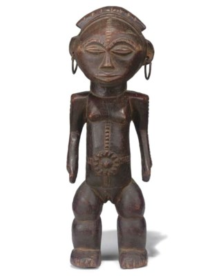 AN AFRICAN CARVED WOOD TRIBAL