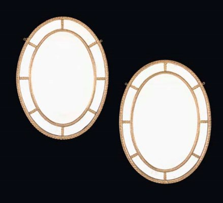 A PAIR OF OVAL GILTWOOD MIRROR