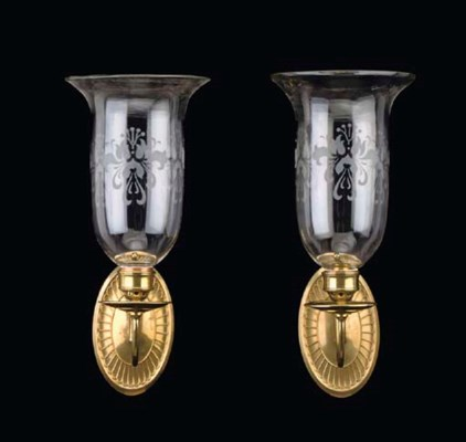 A PAIR OF BRASS AND GLASS WALL