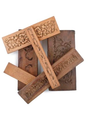 A COLLECTION OF CARVED WOOD MO