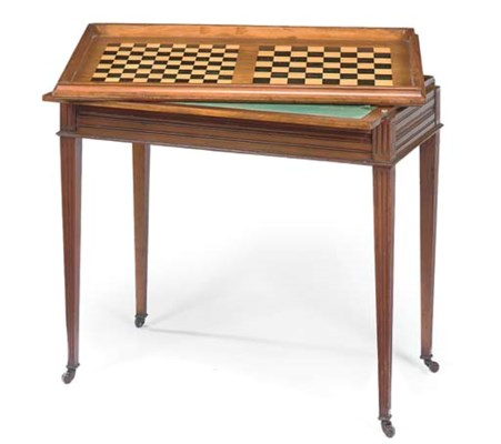AN EDWARDIAN WALNUT HARLEQUIN