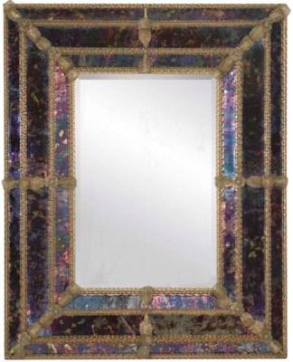 A COLOURED GLASS FRAMED RECTAN