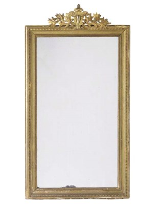 A GILT COMPOSITION MIRROR