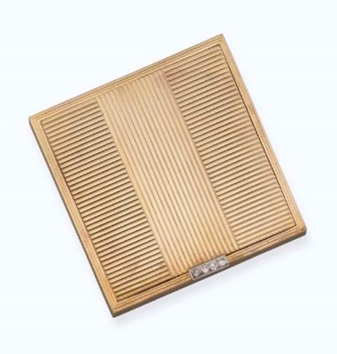 A 9ct. gold and diamond compac
