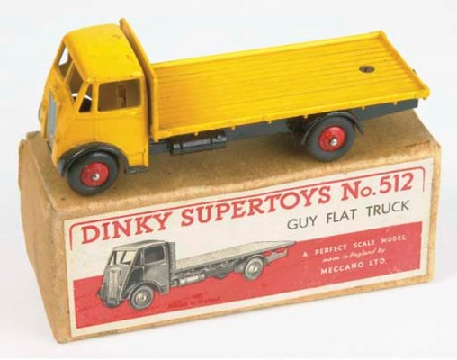 A Dinky yellow 512 Guy Flat Tr