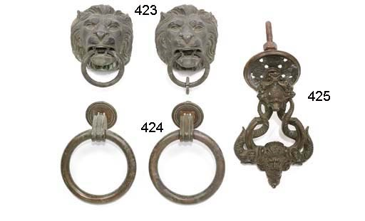 A PAIR OF BRONZE LION MASK RIN