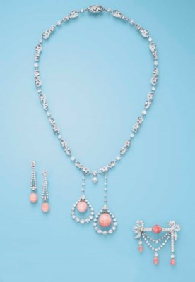 A DIAMOND AND PINK CONCH PEARL
