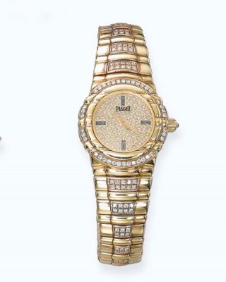 AN 18K GOLD AND DIAMOND LADY'S