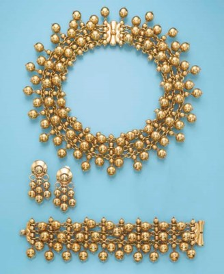 AN 18K GOLD SUITE, BY BULGARI