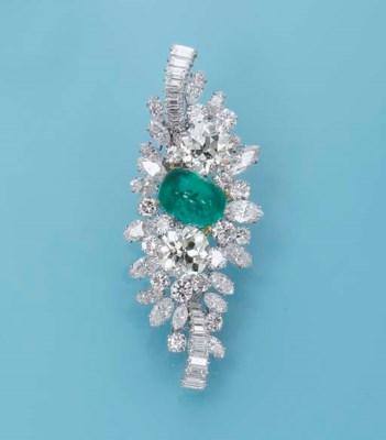 A DIAMOND AND EMERALD BROOCH,