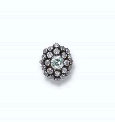 AN ANTIQUE COLOURED DIAMOND AN