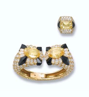 A YELLOW SAPPHIRE, DIAMOND AND