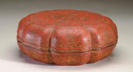 A LARGE CARVED RED LACQUER AND