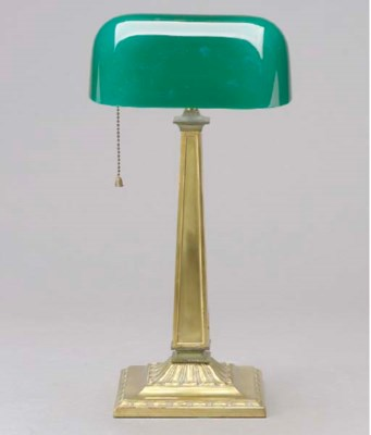 A GILT-METAL DESK LAMP WITH A