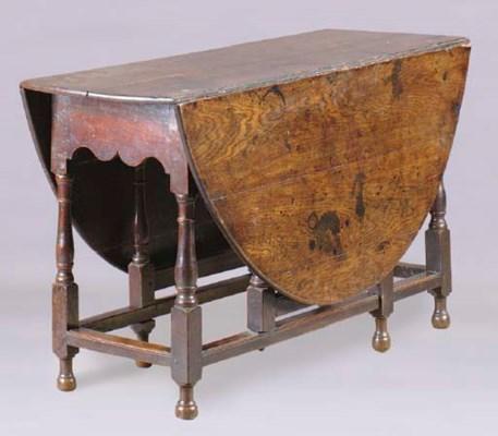 AN ENGLISH OAK GATELEG TABLE,