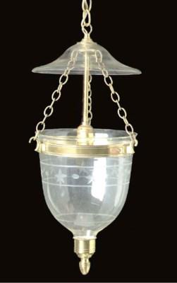 A REGENCY STYLE BRASS AND GLAS