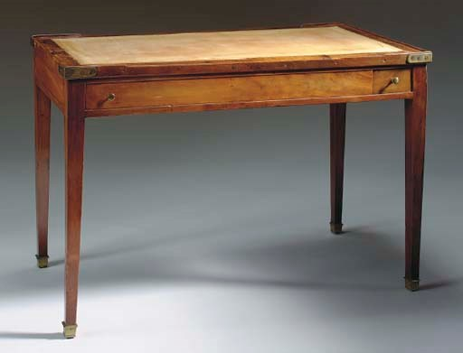 A LATE LOUIS XVI MAHOGANY AND