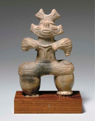An Earthenware Figure of a Wom